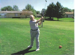 Irvin Fine, playing golf