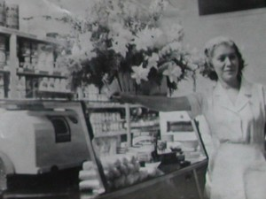 Rose Kravitz by the counter at the original Kravitz's Deli, near Crandall Park, in the 1950s